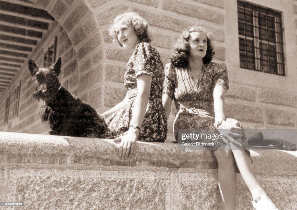 Eva Braun (1912 - 1945, left) and her younger sister Margarethe 'Gretl' Braun (1915 - 1987) with the Scottish terrier Negus at the Kehlsteinhaus (Eagles Nest) above Berchtesgaden, Germany, 1943. Gretl married SS Obergruppenfuhrer Hans Fegelein in June 1944.