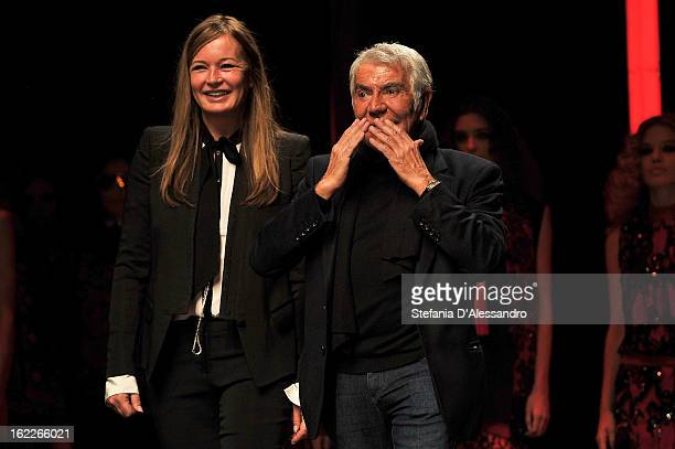 Eva Cavalli and Roberto Cavalli acknowledge the applause of the audience after the Just Cavalli fashion show during Milan Fashion Week Womenswear...
