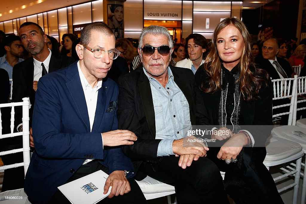<a gi-track='captionPersonalityLinkClicked' href=/galleries/search?phrase=Eva+Cavalli&family=editorial&specificpeople=1719408 ng-click='$event.stopPropagation()'>Eva Cavalli</a> and Roberto Cavalli (C) attend the catwalk show during the Vogue Fashion Dubai Experience at Dubai Mall on October 10, 2013 in Dubai, United Arab Emirates.
