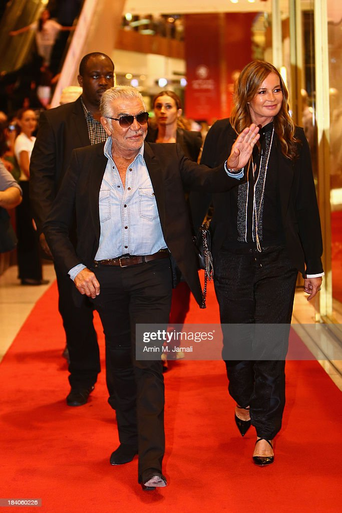 <a gi-track='captionPersonalityLinkClicked' href=/galleries/search?phrase=Eva+Cavalli&family=editorial&specificpeople=1719408 ng-click='$event.stopPropagation()'>Eva Cavalli</a> and Roberto Cavalli attend the catwalk show during the Vogue Fashion Dubai Experience at Dubai Mall on October 10, 2013 in Dubai, United Arab Emirates.
