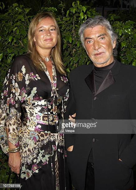 Eva Cavalli and Roberto Cavalli during 2003 Cannes Film Festival Cinema Against Aids 2003 to benefit amfAR sponsored by Miramax Arrivals at Le Moulin...