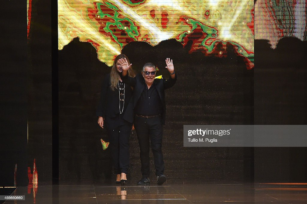 Eva Cavalli and Roberto Cavalli walk the runway during the Just Cavalli show as part of Milan Fashion Week Womenswear Spring/Summer 2015 on September...