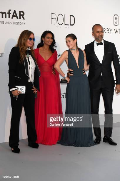 Eva Cavalli Rula Jebreal and guest arrive at the amfAR Gala Cannes 2017 at Hotel du CapEdenRoc on May 25 2017 in Cap d'Antibes France