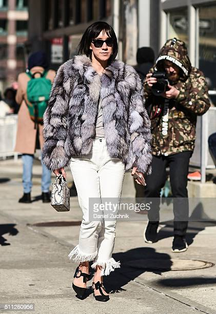 Eva Chen is seen outside the Calvin Klein show wearing a fur coat and white pants during New York Fashion Week Women's Fall/Winter 2016 on February...