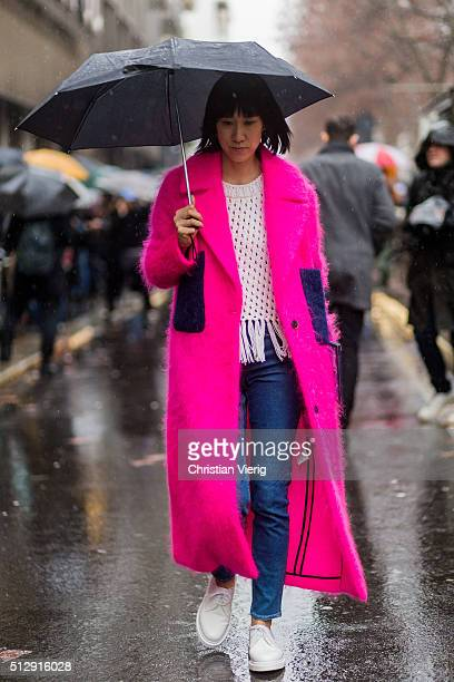 Eva Chen wearing a pink wool coat seen outside Dolce Gabbana during Milan Fashion Week Fall/Winter 2016/17 on February 28 in Milan Italy