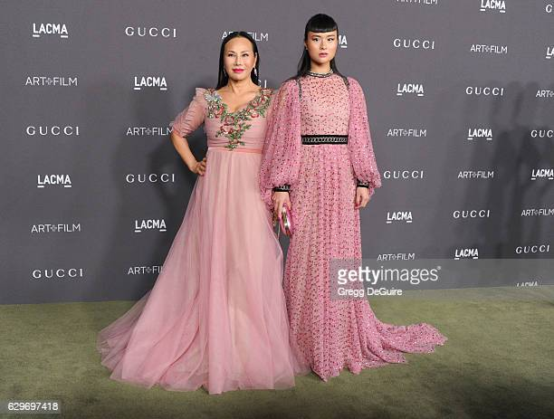 Eva Chow wearing Gucci and Asia Chow arrive at the 2016 LACMA Art Film Gala Honoring Robert Irwin And Kathryn Bigelow Presented By Gucci at LACMA on...