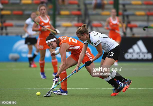 Eva de Goede of the Netherlands is tackled by Katharina Otte of Germany during the Hockey World League Final Pool A match between the Netherlands and...