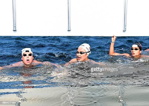 Eva Fabian of the United States of America Samantha Arevalo Salinas of Ecuador and Paola Perez Sierra of Venezuela react at the finish to a gold...