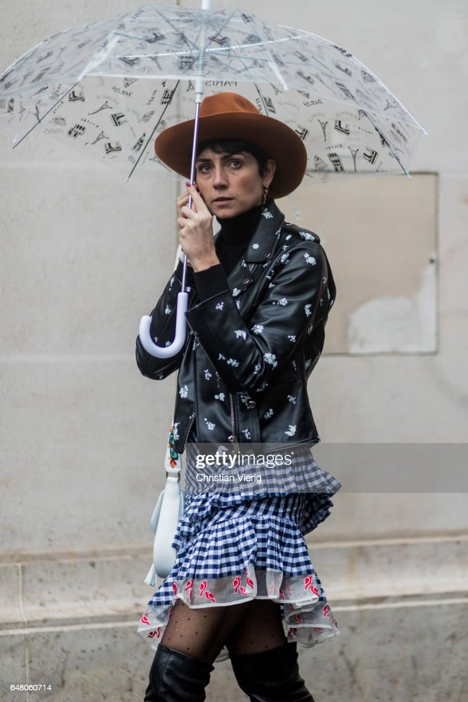 Eva Geraldine Fontanelli wearing a black jacket, checked dress, black overknees, hat, umbrella outside Acne on March 4, 2017 in Paris, France.