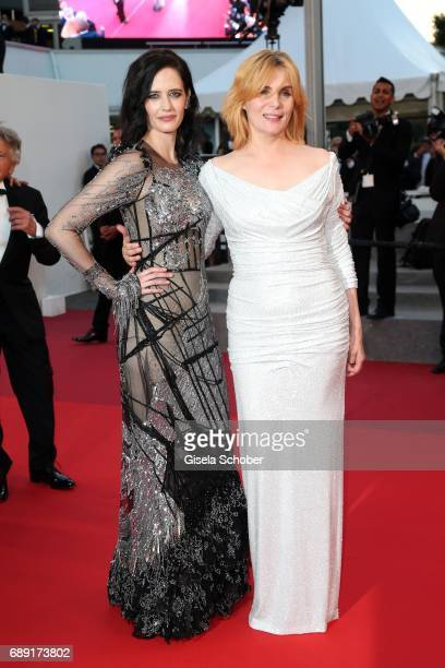 Eva Green and Emmanuelle Seigner leave the 'Based On A True Story' screening during the 70th annual Cannes Film Festival at Palais des Festivals on...