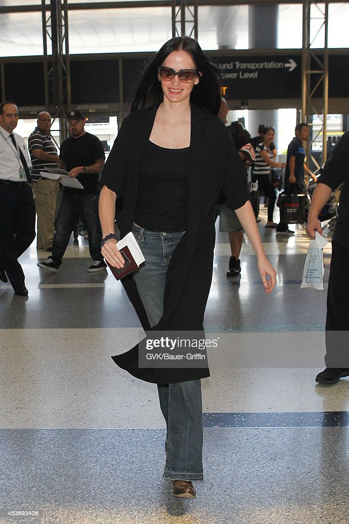 <a gi-track='captionPersonalityLinkClicked' href=/galleries/search?phrase=Eva+Green&family=editorial&specificpeople=211151 ng-click='$event.stopPropagation()'>Eva Green</a> seen at LAX on August 20, 2014 in Los Angeles, California.