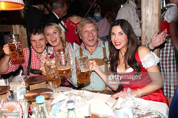 Eva Gruenbauer with husband Richard George Alexandra Polzin and husband Gerhard Leinauer attend the Thomas Sabo Wiesn during Oktoberfest at...