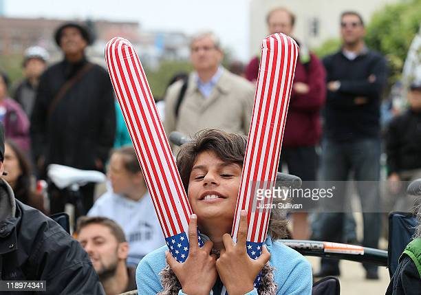 Eva Gruszynski holds American flag thunder sticks as she watches a live telecast of the US women's soccer World Cup semifinal game against France on...