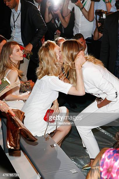 Eva Herzigova and Elle Macpherson attend the Marc Cain show during the MercedesBenz Fashion Week Berlin Spring/Summer 2016 at Brandenburg Gate on...