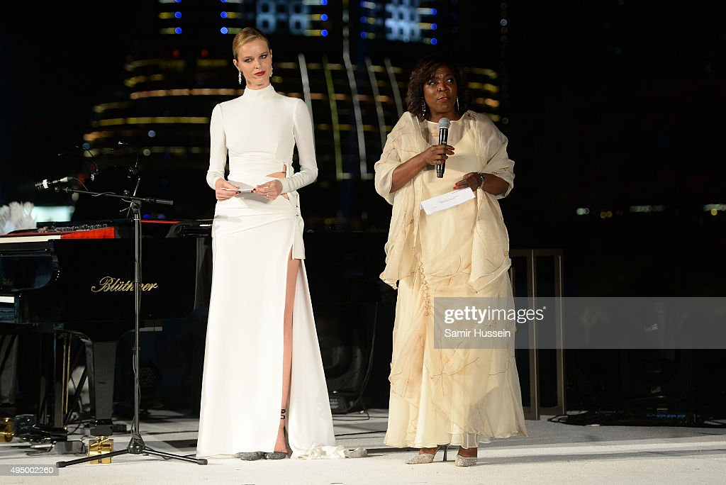 <a gi-track='captionPersonalityLinkClicked' href=/galleries/search?phrase=Eva+Herzigova&family=editorial&specificpeople=156428 ng-click='$event.stopPropagation()'>Eva Herzigova</a> (L) and Executive Director of the United Nations World Food Programme, <a gi-track='captionPersonalityLinkClicked' href=/galleries/search?phrase=Ertharin+Cousin&family=editorial&specificpeople=9100430 ng-click='$event.stopPropagation()'>Ertharin Cousin</a>, speak at the Gala event during the Vogue Fashion Dubai Experience 2015 at Armani Hotel Dubai on October 30, 2015 in Dubai, United Arab Emirates.