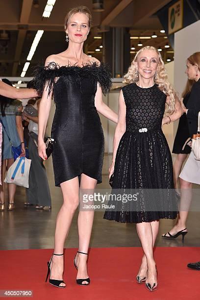 Eva Herzigova and Franca Sozzani attend the Convivio 2014 on June 12 2014 in Milan Italy