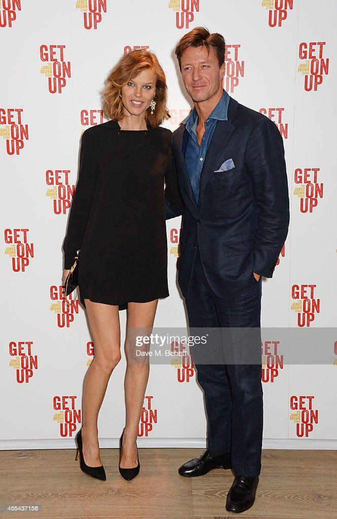 Eva Herzigova (L) and Gregorio Marsiaj attend a special screening of 'Get On Up' at The Ham Yard Hotel on September 14, 2014 in London, England.