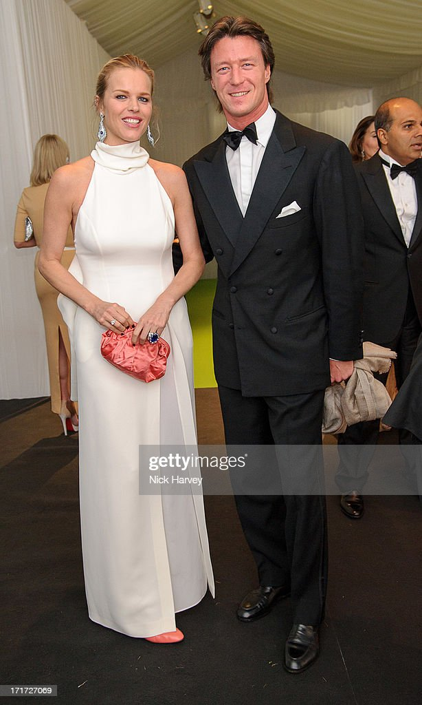 Eva Herzigova and Gregorio Marsiaj attends the 15th Annual White Tie and Tiara Ball to Benefit Elton John AIDS Foundation in Association with Chopard at Woodside on June 27, 2013 in Windsor, England. No sales to online/digital media worldwide until the 14th of July. No sales before July 14th, 2013 in UK, Spain, Switzerland, Mexico, Dubai, Russia, Serbia, Bulgaria, Turkey, Argentina, Chile, Peru, Ecuador, Colombia, Venezuela, Puerto Rico, Dominican Republic, Greece, Canada, Thailand, Indonesia, Morocco, Malaysia, India, Pakistan, Nigeria. All pictures are for editorial use only and mention of 'Chopard' and 'The Elton John Aids Foundation' are compulsory. No sales ever to Ok, Now, Closer, Reveal, Heat, Look or Grazia magazines in the United Kingdom. No sales ever to any jewellers or watchmakers other than Chopard.