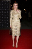 Eva Herzigova attends the preview of The Glamour of Italian Fashion exhibition at Victoria Albert Museum on April 1 2014 in London England