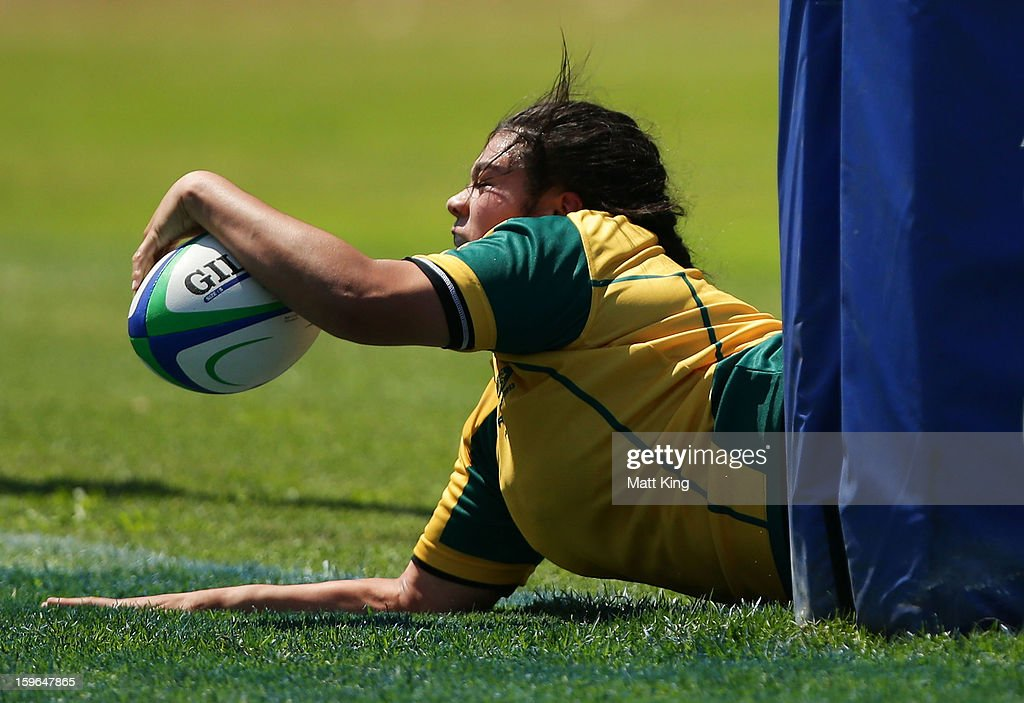Eva Karpani of Australia charges towards the line to score a try in the Women's Rugby Sevens during day three of the Australian Youth Olympic Festival at St Ignatius College on January 18, 2013 in Sydney, Australia.