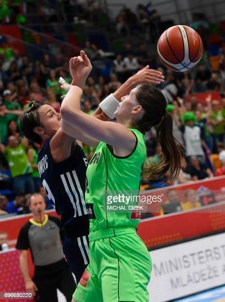Eva Lisec of Slovenia vies for the ball with Celine Dumerc of France during the FIBA EuroBasket women's basketball match Slovania v France on June 16...