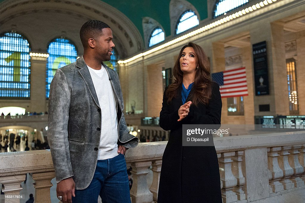 Eva Longoria (R) and AJ Calloway visit 'Extra' at Michael Jordan's The Steak House N.Y.C. in Grand Central Terminal on March 7, 2013 in New York City.