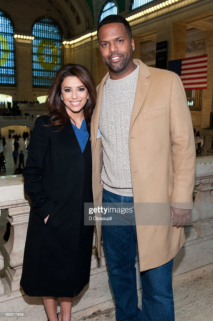 Eva Longoria (L) and AJ Calloway visit 'Extra' at Michael Jordan's The Steak House N.Y.C. in Grand Central Terminal on March 7, 2013 in New York City.