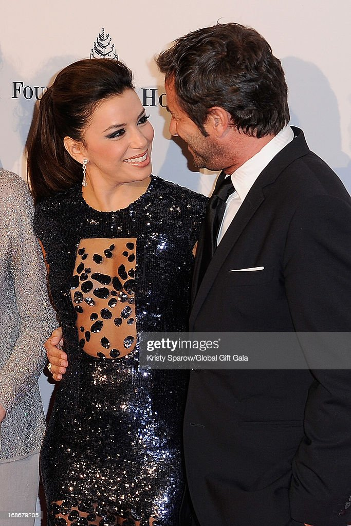 <a gi-track='captionPersonalityLinkClicked' href=/galleries/search?phrase=Eva+Longoria&family=editorial&specificpeople=202082 ng-click='$event.stopPropagation()'>Eva Longoria</a> and <a gi-track='captionPersonalityLinkClicked' href=/galleries/search?phrase=Bernard+Montiel&family=editorial&specificpeople=221485 ng-click='$event.stopPropagation()'>Bernard Montiel</a> attend the 'Global Gift Gala' at Hotel George V on May 13, 2013 in Paris, France.