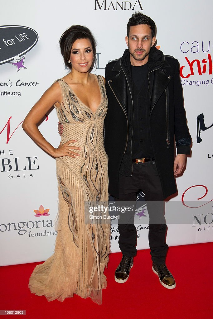 <a gi-track='captionPersonalityLinkClicked' href=/galleries/search?phrase=Eva+Longoria&family=editorial&specificpeople=202082 ng-click='$event.stopPropagation()'>Eva Longoria</a> and Dynamo attend the Noble Gift Gala at The Dorchester on December 8, 2012 in London, England.