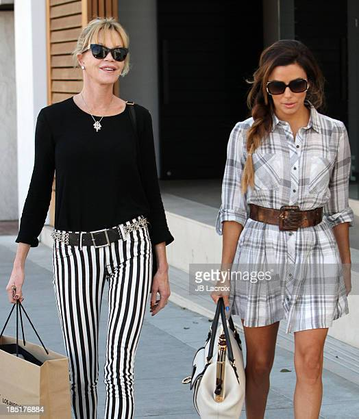 Eva Longoria and Melanie Griffith are seen on October 17 2013 in Los Angeles California