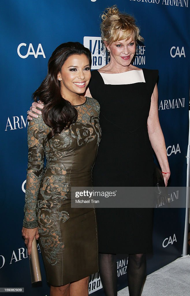 <a gi-track='captionPersonalityLinkClicked' href=/galleries/search?phrase=Eva+Longoria&family=editorial&specificpeople=202082 ng-click='$event.stopPropagation()'>Eva Longoria</a> (L) and <a gi-track='captionPersonalityLinkClicked' href=/galleries/search?phrase=Melanie+Griffith&family=editorial&specificpeople=171682 ng-click='$event.stopPropagation()'>Melanie Griffith</a> arrive at the 2nd Annual Sean Penn & Friends 'Help Haiti Home' held at Montage Hotel on January 12, 2013 in Los Angeles, California.