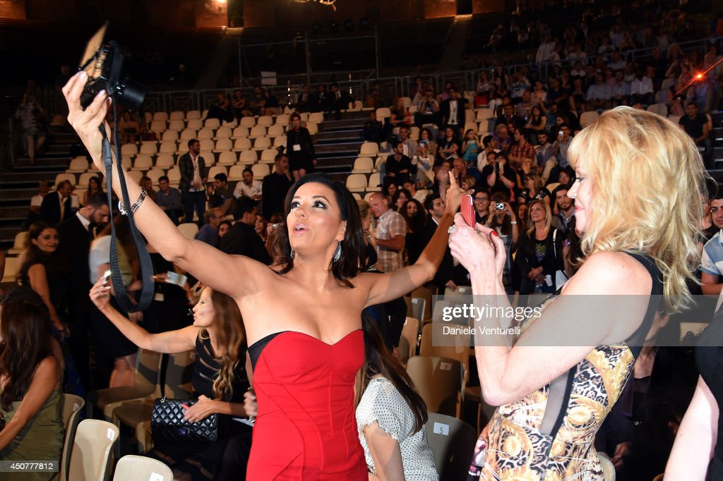 <a gi-track='captionPersonalityLinkClicked' href=/galleries/search?phrase=Eva+Longoria&family=editorial&specificpeople=202082 ng-click='$event.stopPropagation()'>Eva Longoria</a> and <a gi-track='captionPersonalityLinkClicked' href=/galleries/search?phrase=Melanie+Griffith&family=editorial&specificpeople=171682 ng-click='$event.stopPropagation()'>Melanie Griffith</a> take pictures as they attend the 60th Taormina Film Fest on June 17, 2014 in Taormina, Italy.