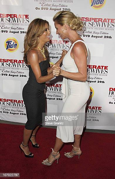Eva Longoria and Nicollette Sheridan during 'Desperate Housewives Season 2 Extra Juicy Edition' DVD Launch Event Arrivals at 'Wisteria Lane'...
