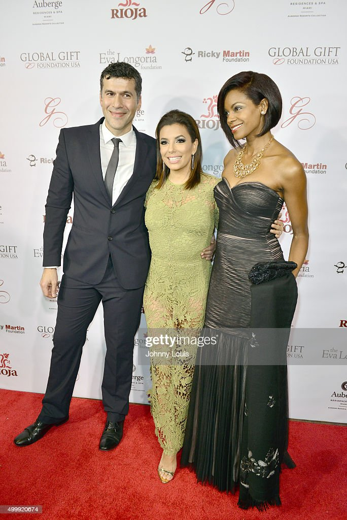 Eva Longoria (C) and Pablo and Celete Olay attend the Global Gift Foundation Dinner at Auberge Residences & Spa sales office on December 3, 2015 in Miami, Florida.