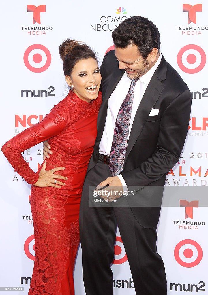 Eva Longoria and Ricardo Chavira arrive at the 2013 NCLR ALMA Awards held at Pasadena Civic Auditorium on September 27 2013 in Pasadena California
