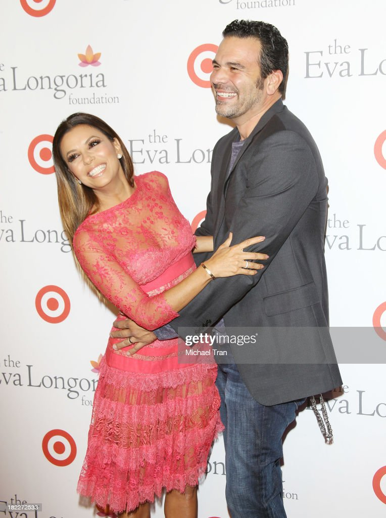Eva Longoria and Ricardo Chavira arrive at The Eva Longoria Foundation Dinner held at Beso on September 28 2013 in Hollywood California