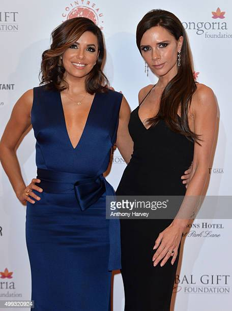 Eva Longoria and Victoria Beckham attend The Global Gift Gala at Four Seasons Hotel on November 30 2015 in London England
