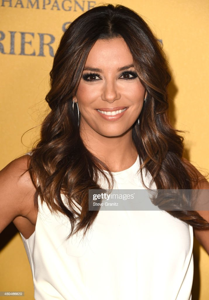 <a gi-track='captionPersonalityLinkClicked' href=/galleries/search?phrase=Eva+Longoria&family=editorial&specificpeople=202082 ng-click='$event.stopPropagation()'>Eva Longoria</a> arrives at the Women In Film 2014 Crystal + Lucy Awards at the Hyatt Regency Century Plaza on June 11, 2014 in Century City, California.