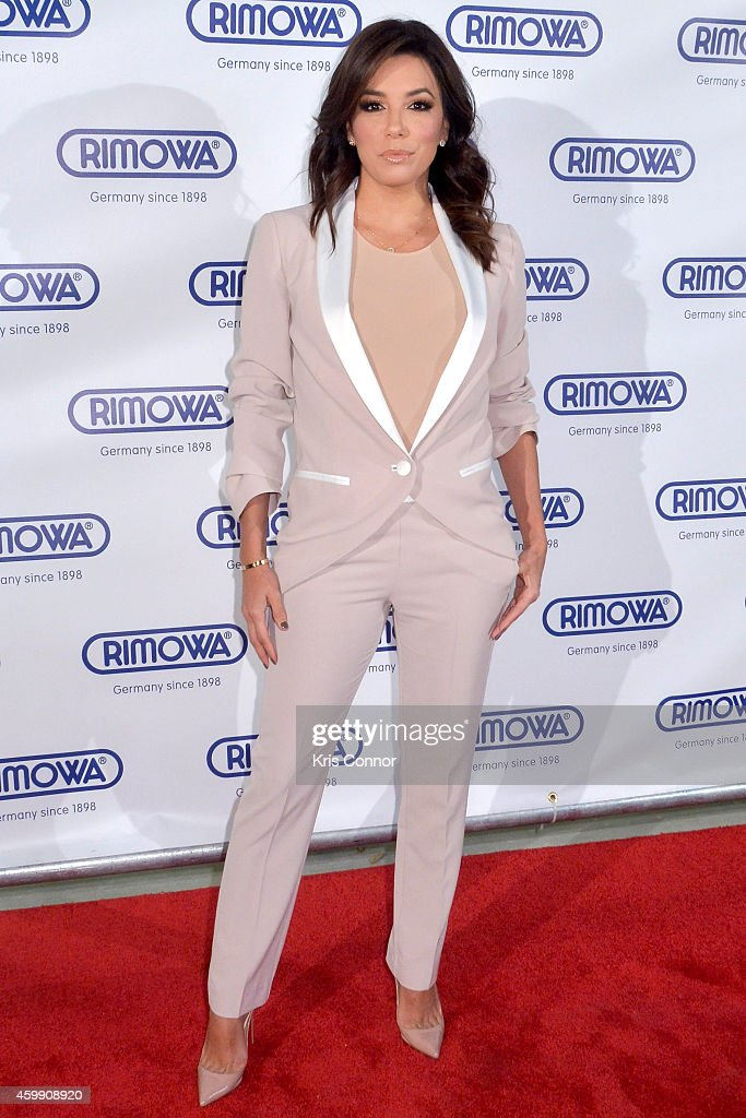 Eva Longoria attends Rimowa store opening on December 3, 2014 in Miami, Florida.