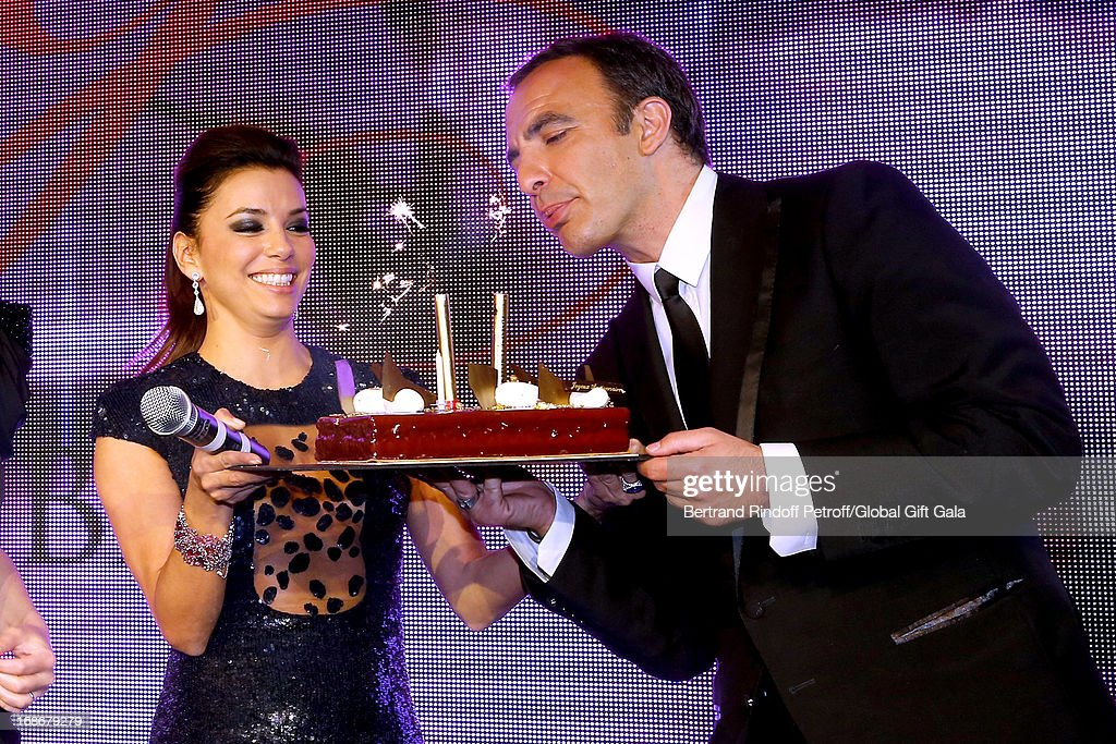 Eva Longoria gives a Birthday Cake to Nikos Aliagas which has 44 years old today - 'Global Gift Gala' at Hotel George V on May 13, 2013 in Paris, France.