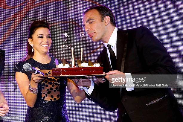 Eva Longoria gives a Birthday Cake to Nikos Aliagas which has 44 years old today 'Global Gift Gala' at Hotel George V on May 13 2013 in Paris France