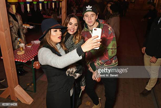 Eva Longoria Melanie Chisholm and Brooklyn Beckham attend a VIP Preview of Hyde Park's Winter Wonderland 2016 on November 17 2016 in London United...