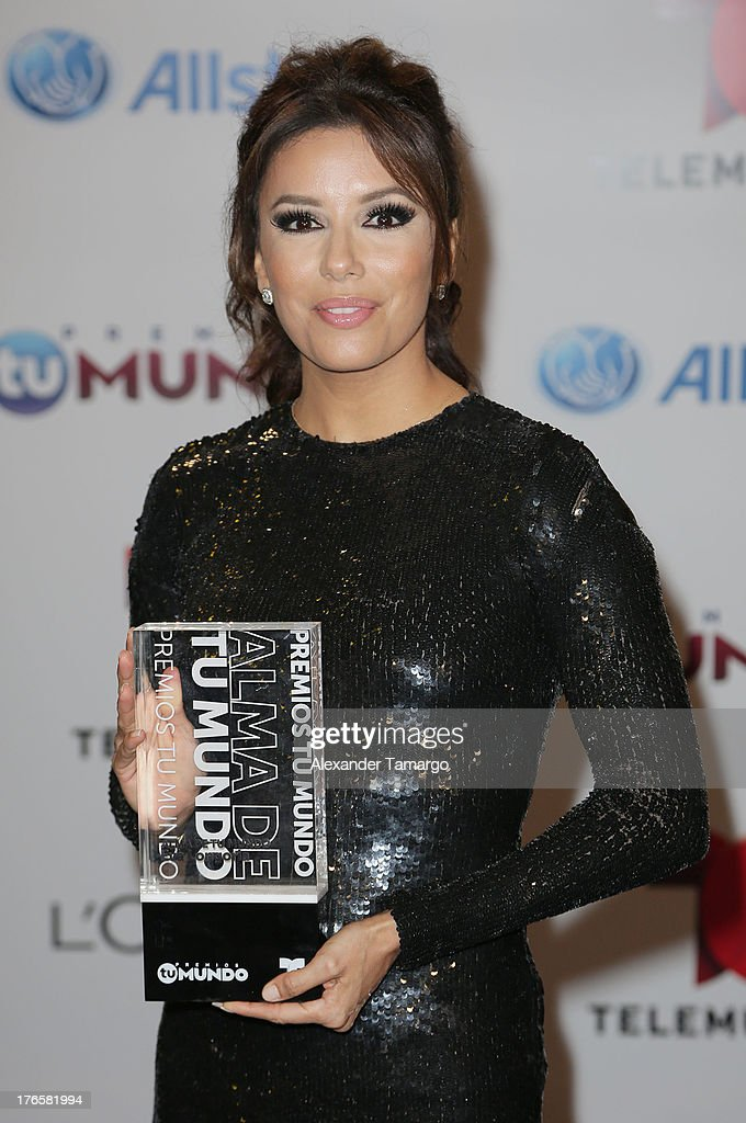 <a gi-track='captionPersonalityLinkClicked' href=/galleries/search?phrase=Eva+Longoria&family=editorial&specificpeople=202082 ng-click='$event.stopPropagation()'>Eva Longoria</a> poses backstage at Telemundo's Premios Tu Mundo Awards at American Airlines Arena on August 15, 2013 in Miami, Florida.