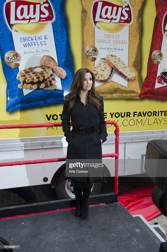 Eva Longoria poses for photographers during NYSE Celebrates Lay's 'Do Us a Flavor' Contest Finalists during the opening bell at New York Stock Exchange on February 12, 2013 in New York City.