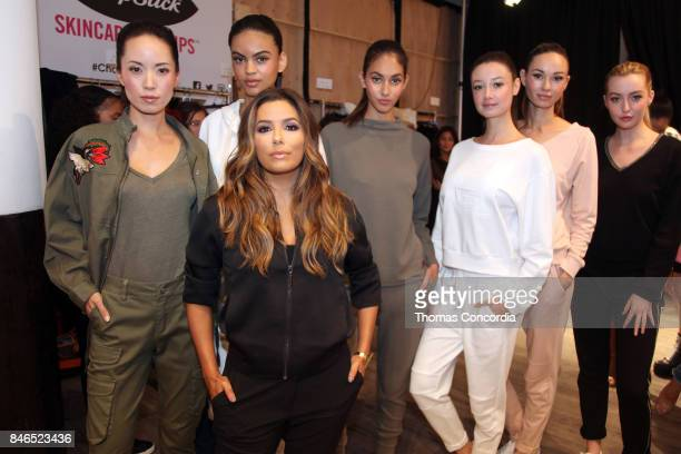 Eva Longoria poses with models backstage at Kia STYLE360 Hosts Eva Longoria Collection at Metropolitan West on September 13 2017 in New York City