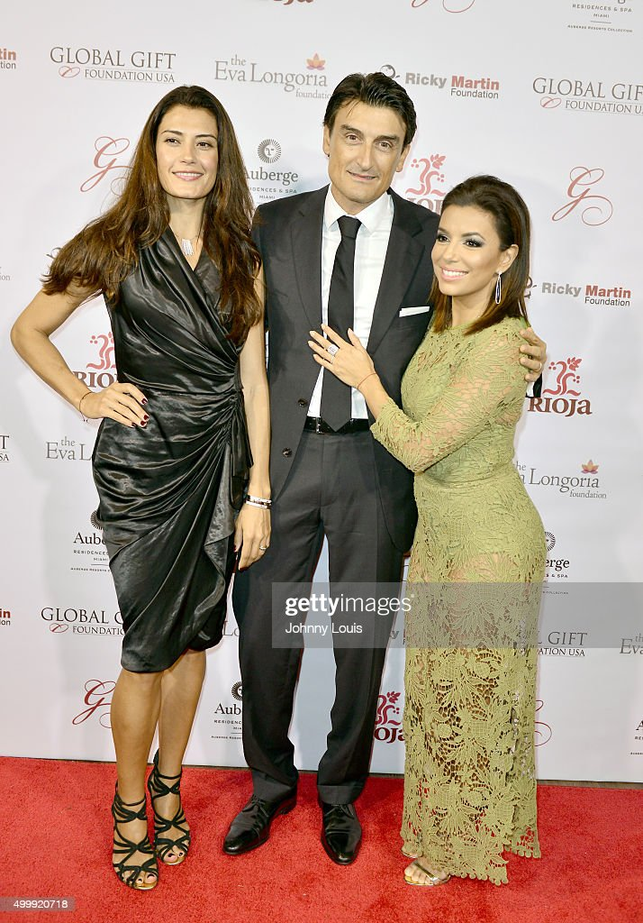 Eva Longoria, Raffaele Capoferro and Maria Ines Capoferro attend the Global Gift Foundation Dinner at Auberge Residences & Spa sales office on December 3, 2015 in Miami, Florida.