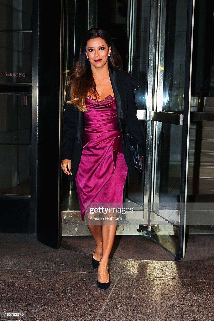 <a gi-track='captionPersonalityLinkClicked' href=/galleries/search?phrase=Eva+Longoria&family=editorial&specificpeople=202082 ng-click='$event.stopPropagation()'>Eva Longoria</a> seen leaving her Midtown hotel on October 24, 2013 in New York City.