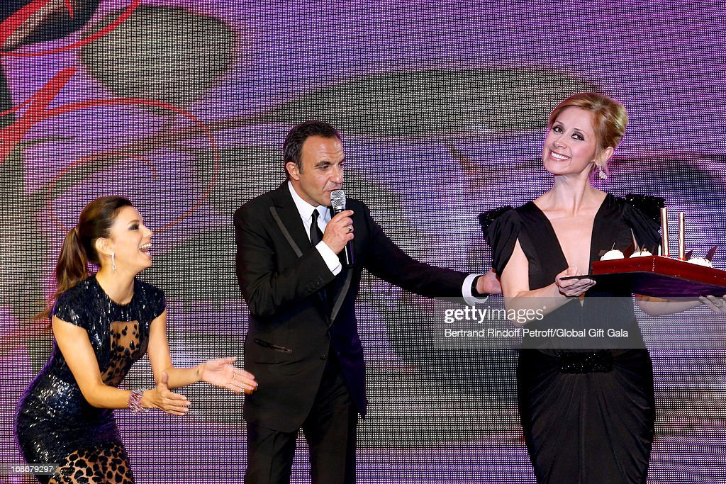 Eva Longoria (L), Singer Lara Fabian (R) give a Birthday Cake to Nikos Aliagas (C) which has 44 years old today - 'Global Gift Gala' at Hotel George V on May 13, 2013 in Paris, France.
