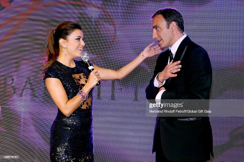 <a gi-track='captionPersonalityLinkClicked' href=/galleries/search?phrase=Eva+Longoria&family=editorial&specificpeople=202082 ng-click='$event.stopPropagation()'>Eva Longoria</a> singing Happy Birthday to <a gi-track='captionPersonalityLinkClicked' href=/galleries/search?phrase=Nikos+Aliagas&family=editorial&specificpeople=573643 ng-click='$event.stopPropagation()'>Nikos Aliagas</a> which has 44 years old today - 'Global Gift Gala' at Hotel George V on May 13, 2013 in Paris, France.