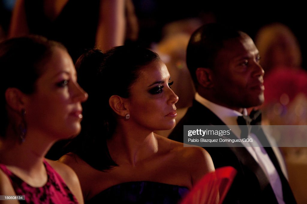 Eva Longoria (C) speaks with Julio Baptista (R) watch the Global Gift Gala held to raise benefits for Cesare Scariolo Foundation and Eva Longoria Foundation on August 19, 2012 in Marbella, Spain.
